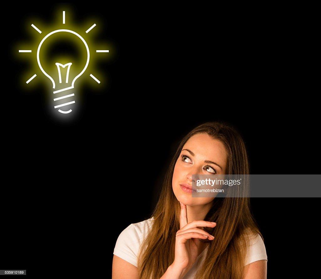 pensive asian caucasian woman looking into copyspace : Stock Photo