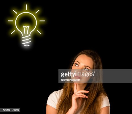 pensive asian caucasian woman looking into copyspace : Stock Photo