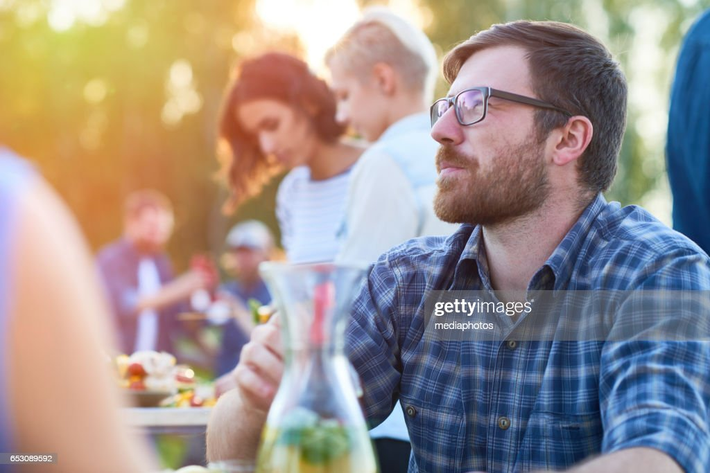 Pensive bearded guy at party : Stock Photo