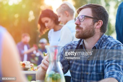 Pensive bearded guy at party : Photo