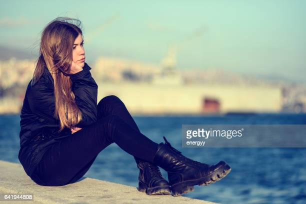 Pensive blond young woman