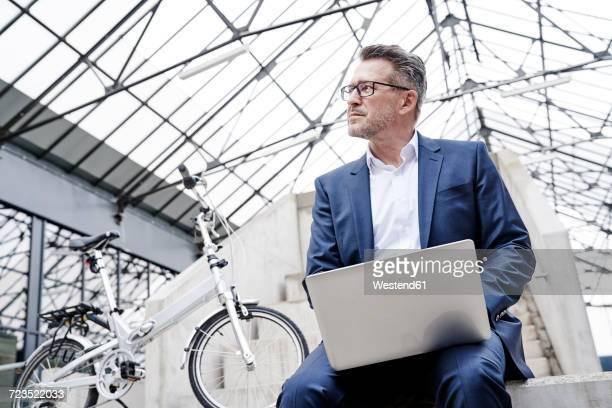 Pensive businessman with laptop