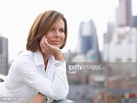 Pensive Businesswoman Downtown
