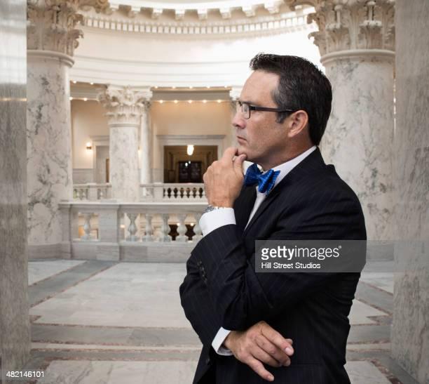 Pensive Caucasian politician in government building