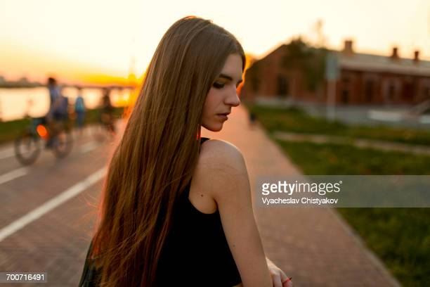 Pensive Caucasian woman at waterfront