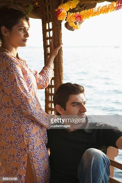 Pensive couple on houseboat, India