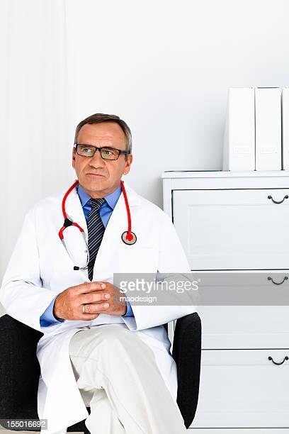 Pensive Doctor in White Lab Coat, Studio Shot