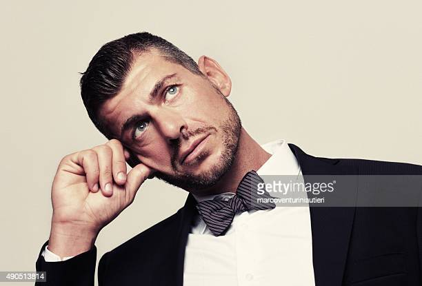 Pensive elegant man, looking away