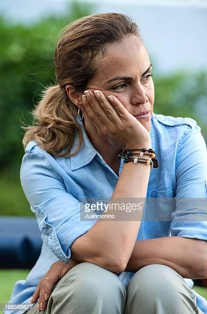 Pensive hispanic mature  woman