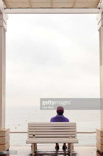 Pensive Man on a Bench Looking Sea.Copy Space.