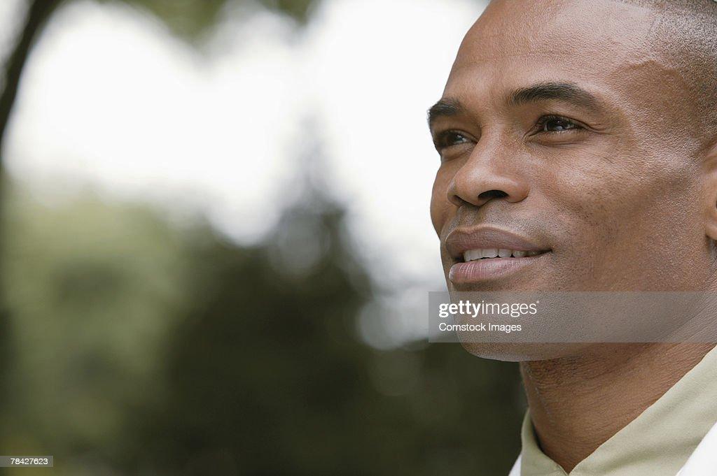 Pensive man smiling
