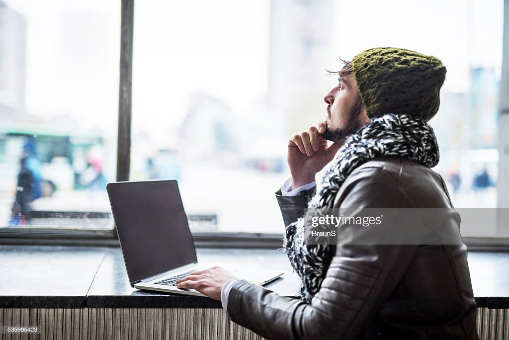 Pensive man using laptop. : Stock Photo