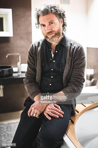 pensive mature man with long beard