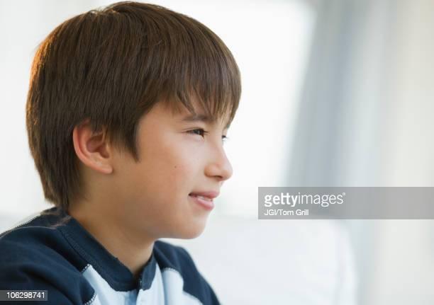 Pensive mixed race boy