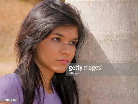 Pensive Teenager staring out into the unknown : Stock Photo