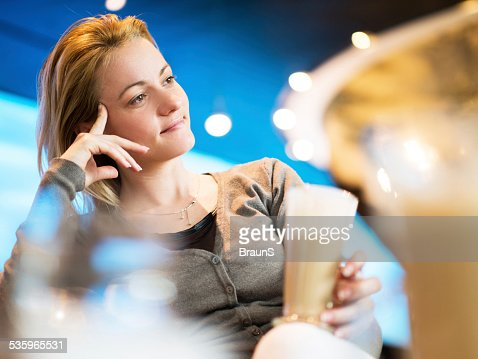 Pensive woman in a cafe. : Stock Photo