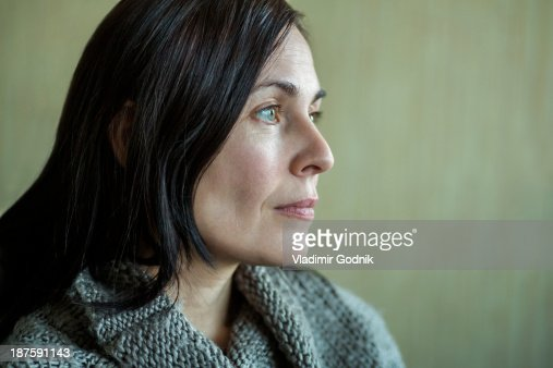 Pensive woman looking into distance