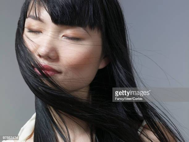 Pensive woman with long flowing hair