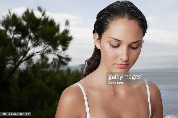 Pensive young woman, outdoors