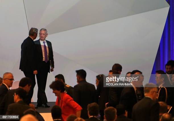 US Pentagon chief Jim Mattis and John Chipman directorgeneral and chief executive IISS walk out after the first plenary session at the 16th Institute...