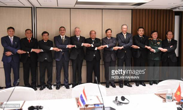 US Pentagon chief Jim Mattis poses with with ASEAN defence leaders during the 16th Institute for Strategic Studies ShangriLa Dialogue Summit in...