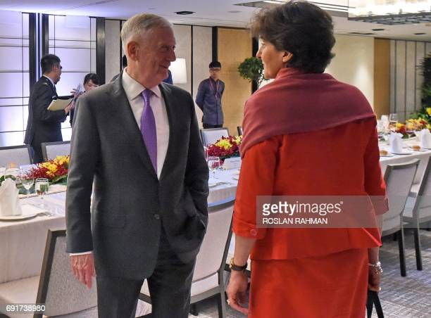 US Pentagon chief Jim Mattis talks to France's Minister for Armed Forces Sylvie Goulard during a luncheon at the 16th Institute for Strategic Studies...