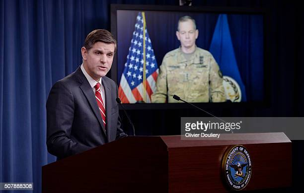 Pentagon Press Secretary Peter Cook speaks as Combined Joint Task Force Commander Army Lt Gen Sean MacFarland listens via teleconference from Baghdad...