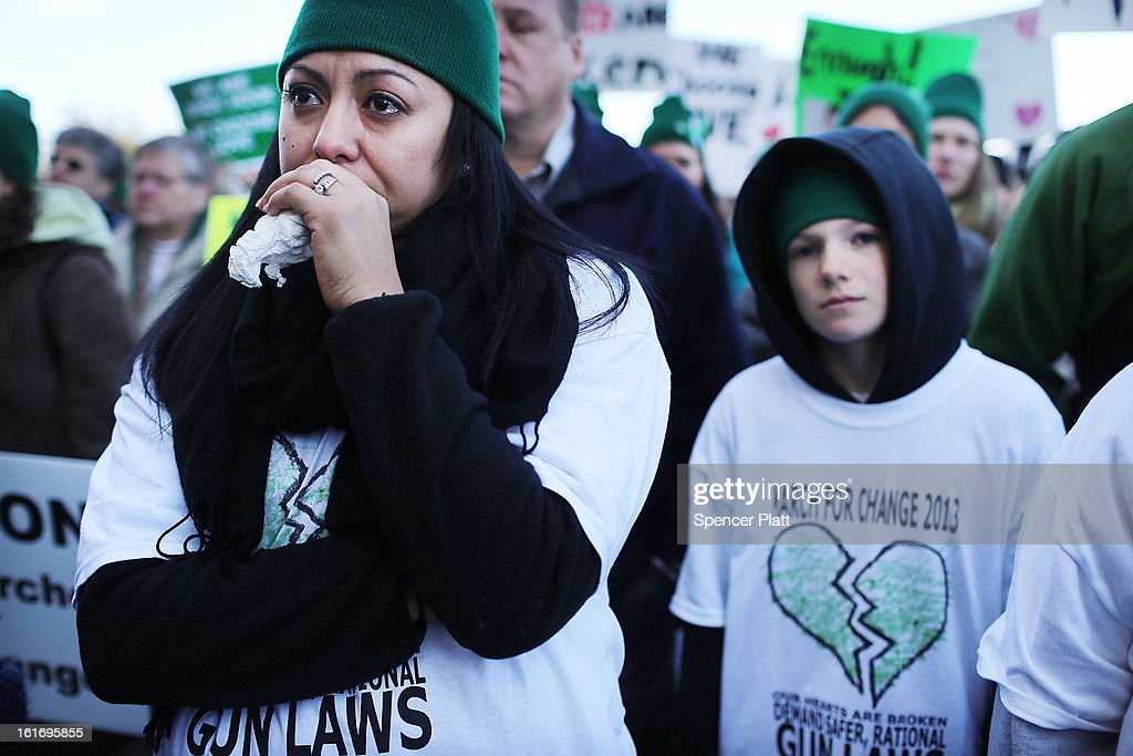 Peole attend a rally at the Connecticut State Capital to promote gun control legislation in the wake of the December 14, 2012, school shooting in Newtown on February 14, 2013 in Hartford, Connecticut. Referred to as the 'March for Change' and held on the two-month anniversary of the massacre in Newtown, Connecticut, participants called for improved gun safety laws. Among the safety measures being demanded are for universal background checks, more work within the mental health community and restricting high-capacity magazines.