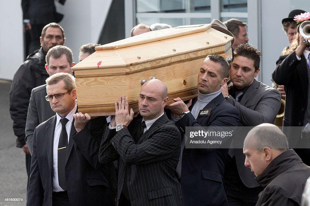 Peole carry the coffin of Stephane Charbonnier, also known as Charb, the publishing director of the satirical paper Charlie Hebdo during his funeral ceremony in Pontoise near Paris, France on January 16, 2015.