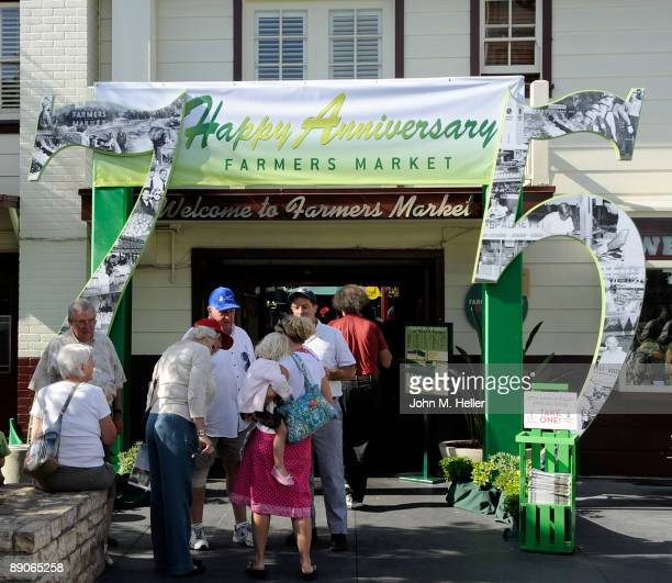 Peole stand during the 75th Anniversary Birthday Party for the original Farmers Market July 16 2009 in Los Angeles California
