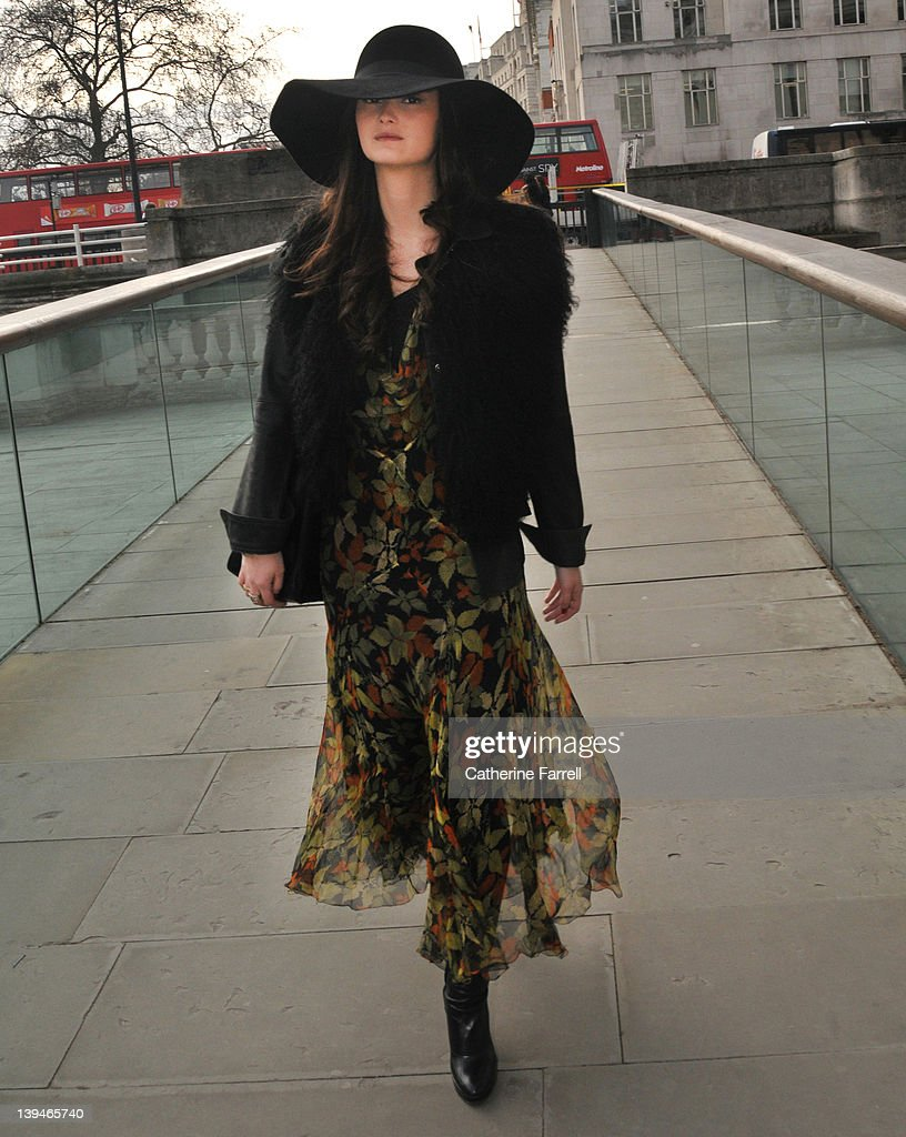Peony Lim, Blogger, wearing russet and moss green autumunal leaf print vintage chiffon dress, black Zara jacket, Joseph hat and Fendi bag at London Fashion Week Autumn/Winter 2012 at on February 21, 2012 in London, England.