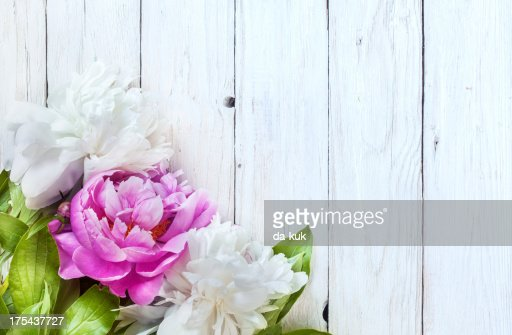 Peony on aged wooden table