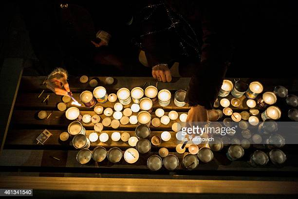 Peopel light candles during rally outside the French embassy on January 11 2015 in TelAviv Israel Four bodies of victims of the terrorist attack in...