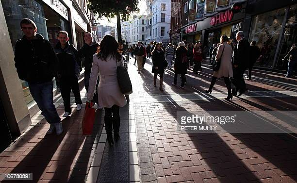 Peopl walk along Grafton Street the main shopping area of Dublin in Ireland on November 12 2010 Ireland's Finance Minister Brian Lenihan said Friday...