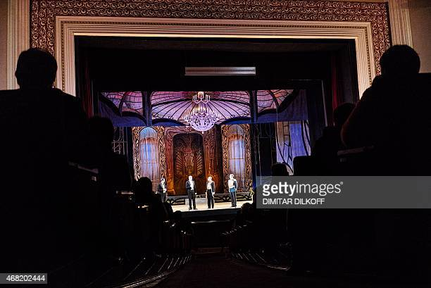 Peopla attend a performance of 'The Merry Widow' operetta by the AustroHungarian composer Franz Lehar at the Donetsk State Academic Opera and Ballet...
