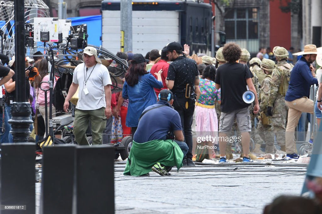 "People acting as extras are seen on a street closed to the traffic during the filming of scenes of the movie ""Godzilla, King of the Monsters"" in the historical centre of Mexico City on August 20, 2017. Godzilla invades Mexico City as scenes from the Japanese monster's latest movie directed by Michael Dougherty are filmed in the capital."
