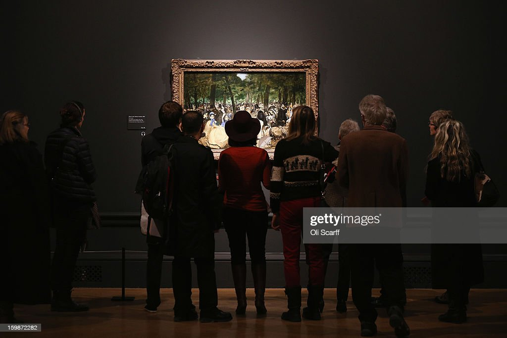 People admire a painting by Edouard Manet entitled 'Music in the Tuileries Gardens' in the Royal Academy of Arts on January 22, 2013 in London, England. The painting features in the Royal Academy's new exhibition 'Manet: Portraying Life' which displays over 50 paintings spanning his career. The exhibition open to the general public on January 26, 2013 and runs until April 14, 2013.