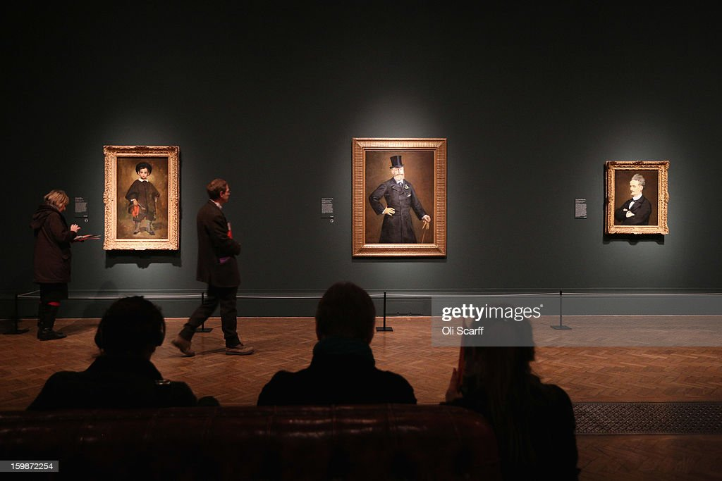 People admire a painting by Edouard Manet entitled 'Portrait of M.Antonin Proust' (C) in the Royal Academy of Arts on January 22, 2013 in London, England. The painting features in the Royal Academy's new exhibition 'Manet: Portraying Life' which displays over 50 paintings spanning his career. The exhibition open to the general public on January 26, 2013 and runs until April 14, 2013.
