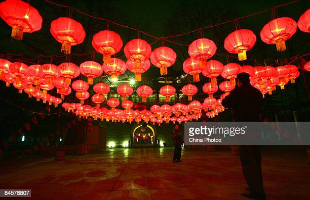 People admire Chinese lanterns at the Small Wild Goose Pagoda the symbol of the oldline Xian on February 1 2009 in Xian of Shaanxi Province China...