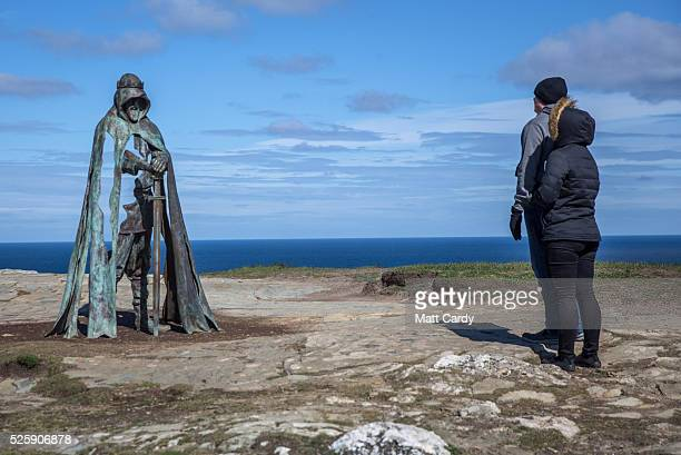 People admire the new 'Gallos' sculpture that has been erected at Tintagel Castle in Tintagel on April 28 2016 in Cornwall England The English...