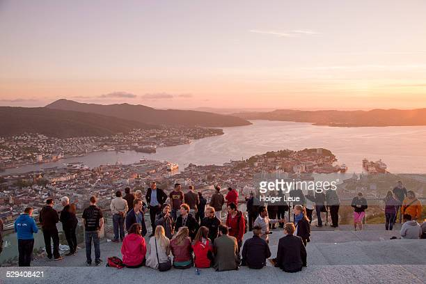 People admire view from Mt. Floien at sunset