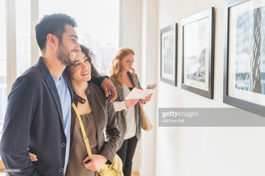 People admiring art in gallery