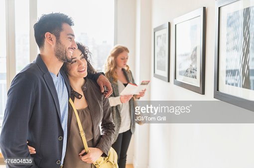 People admiring art in gallery