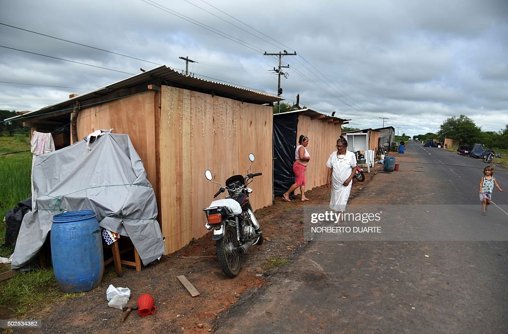 People affected by floods set up improvised shacks in Falcon 42 km west from Asuncion in the ParaguayArgentina border on December 26 2015 Flooding...