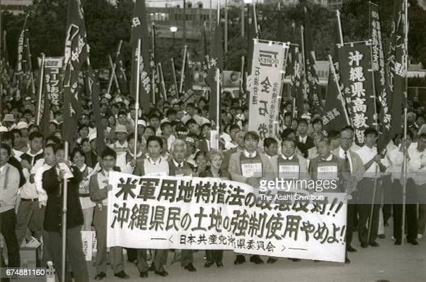 People against a special measure law for the US military bases hold a rally on April 15 1997 in Naha Okinawa Japan