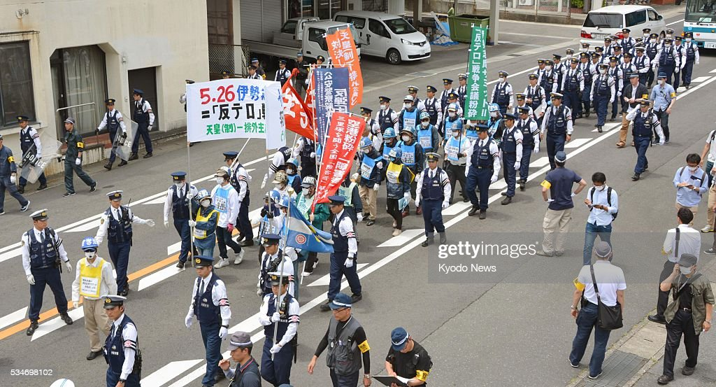 People against the Group of Seven Ise-Shima summit stage a small-scale demonstration in the central Japan city of Shima on May 26, 2016, saying the G-7 leaders should not be at liberty to set the world's standards.