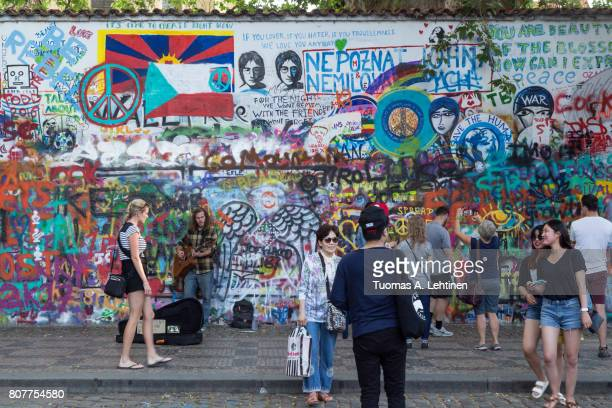 People and art at the Lennon Wall in Prague
