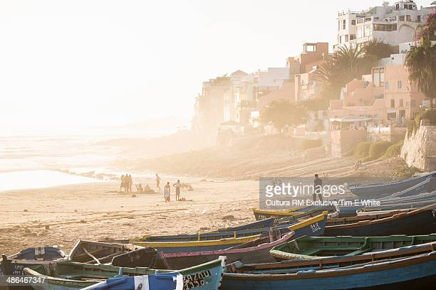 People and boats on beach, Taghazout, Morocco