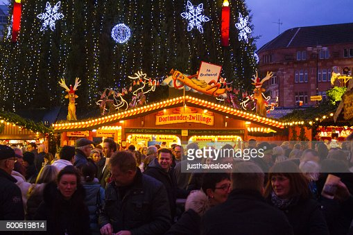 People and booth for sausages on xmas market