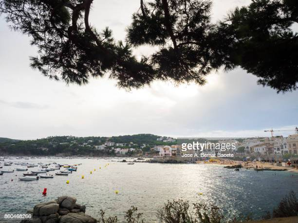 People and Caleya beach close to the sea with tourists in summer. Calella, Coast Brava, Girona, Spain